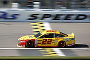 NASCAR Sprint Cup Series auto racing driver Joey Logano takes a practice lap at Kansas Speedway in Kansas City, Kan., Saturday, Oct. 17, 2015. (AP Photo/Colin E. Braley)
