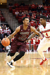 28 January 2015:  Dorrian Williams works the perimeter guarded by Bobby Hunter during an NCAA MVC (Missouri Valley Conference) men's basketball game between the Missouri State Bears and the Illinois State Redbirds at Redbird Arena in Normal Illinois