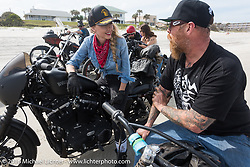 Leticia Cline and Bill Dodge chatting on the beach at Daytona Bike Week 75th Anniversary event. FL, USA. Thursday March 3, 2016.  Photography ©2016 Michael Lichter.