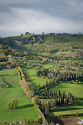 A winding lane leads to a private estate in the green fields below Orvieto, Umbria, Italy.