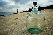 A bottle on the beach in Tulum, Riviera Maya, Mexico. © 2007 Scott Morgan