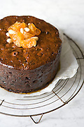 Mcc0016996 . Daily Telegraph..Weekend section..Christmas Planning : Rose prince making a Christmas Cake with cristallized clementines and an apricot glaze...London 29 September 2009