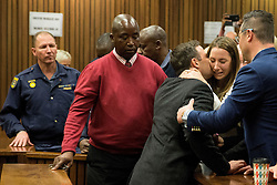 South African Paralympian athlete Oscar Pistorius (C) holds his sister Aimee Pistorius (3rd R) as he leaves the High Court in Pretoria, on July 6, 2016 after beeing sentenced to six years in jail for murdering his girlfriend Reeva Steenkamp three years ago..High Court judge Thokozile Masipa listed several mitigating factors for sentencing Pistorius to less than half the minimum 15-year term for murder, including the athlete's claim he believed he was shooting an intruder. Oscar Pistorius will not appeal against his six-year jail term. / AFP PHOTO / POOL / MARCO LONGARI (Credit Image: © Marco Longari/Xinhua via ZUMA Wire)