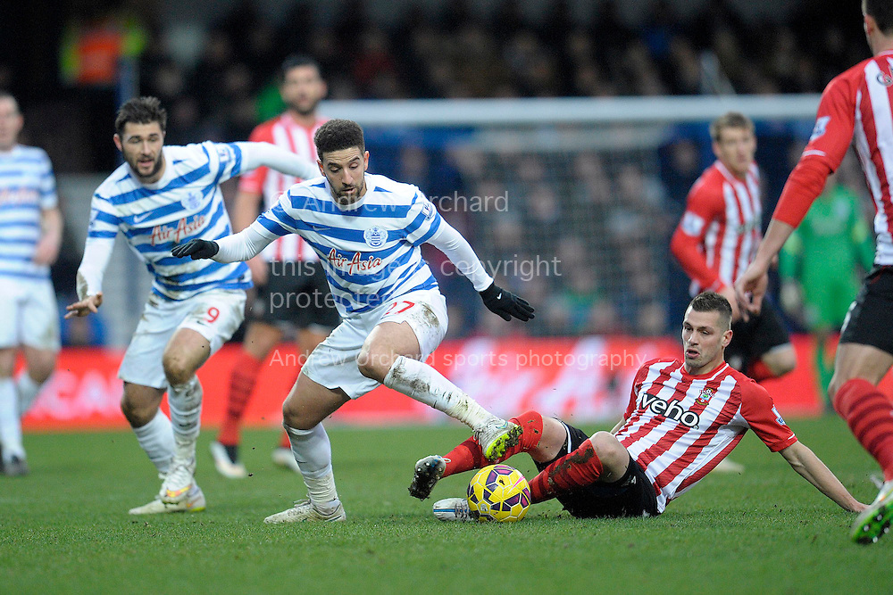 Adel Taarabt of QPR being intercepted by Morgan Schneiderlin of Southampton. Barclays Premier league match, Queens Park Rangers v Southampton at Loftus Road in London on Saturday 7th Feb 2015. pic by John Patrick Fletcher, Andrew Orchard sports photography.