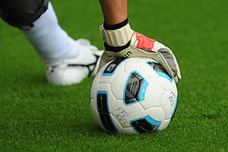Generic view of a match ball and goalkeeper glove