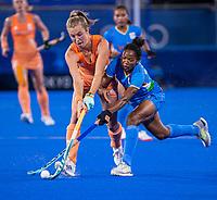 TOKIO -  Xan de Waard (NED) met  Salima Tete (IND) tijdens de wedstrijd dames , Nederland-India (5-1) tijdens de Olympische Spelen   .   COPYRIGHT KOEN SUYK