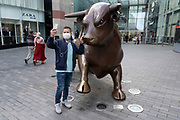As numbers of Covid-19 cases in Birmingham have dramatically risen in the past week, increased lockdown measures have been announced for Birmingham and other areas of the West Midlands, a man takes a selfie with Bully the Bull Ring bull in the city centre on 12th September 2020 in Birmingham, United Kingdom. With the rule of six also being implemented the Birmingham area has now be escalated to an area of national intervention, with a ban on people socialising with people outside their own household, unless they are from the same support bubble.