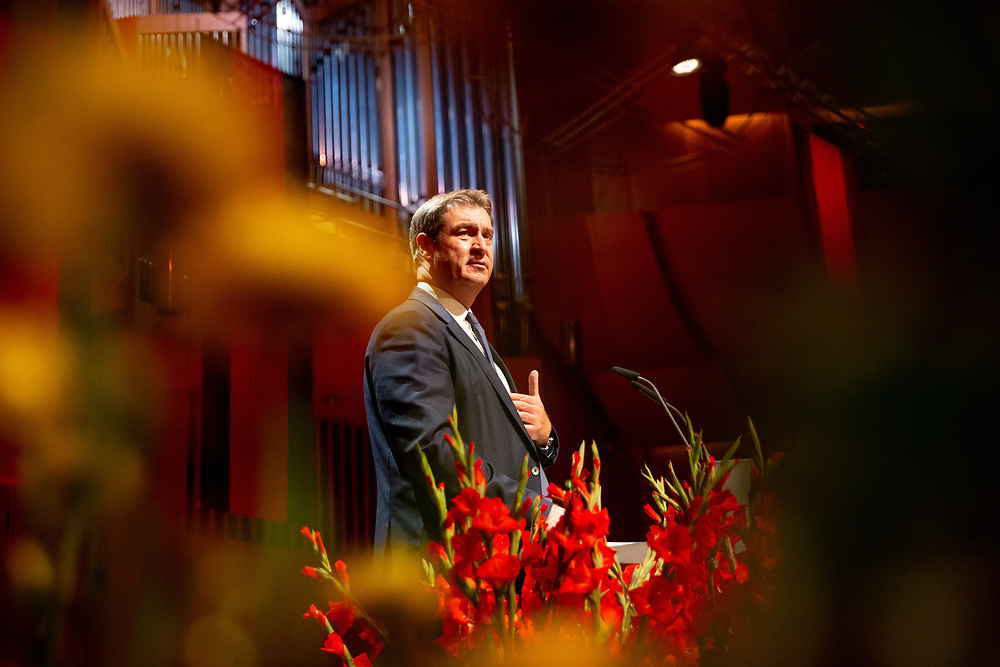 """Bavarian State Premier Markus Söder speaking at the ceremony including the awarding of the European Charles Prize  during the 71st Sudeten German meeting at the """"Philharmonie im Gasteig"""" in Munich."""