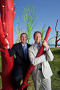 Adam Schwerner, right, Director of Natural Resources/Liason to The Museums in the Park, and Michael Kelly, Chicago Park District Superintendent pose with painted trees at the south lakefront beach and harbor.  Schwerner came up with the idea to save dead trees, paint them, and mount them in concrete footings.