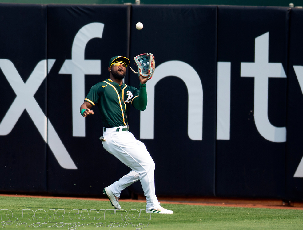 Sep 25, 2021; Oakland, California, USA; Oakland Athletics center fielder Starling Marte (2) makes the catch of a deep fly ball by Houston Astros third baseman Alex Bregman during the first inning at RingCentral Coliseum. Mandatory Credit: D. Ross Cameron-USA TODAY Sports