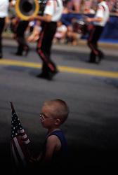 Americana young boy waves american flag Stock photo
