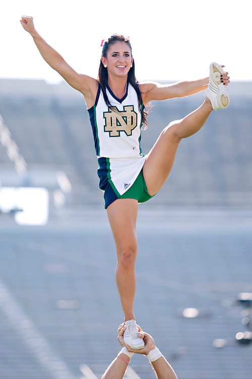 Notre Dame cheerleader Courtney Leader practices before NCAA football game between Notre Dame and Air Force.  The Notre Dame Fighting Irish defeated the Air Force Falcons 59-33 in game at Notre Dame Stadium in South Bend, Indiana.
