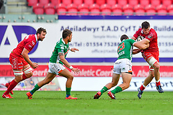 Ed Kennedy of Scarlets is tackled by Alberto Sgarbi of Benetton Treviso<br /> <br /> Photographer Craig Thomas/Replay Images<br /> <br /> Guinness PRO14 Round 3 - Scarlets v Benetton Treviso - Saturday 15th September 2018 - Parc Y Scarlets - Llanelli<br /> <br /> World Copyright © Replay Images . All rights reserved. info@replayimages.co.uk - http://replayimages.co.uk