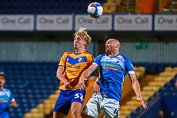 George Lapslie of Mansfield Town and Jason Taylor of Barrow jump to head the ball - Mandatory by-line: Ryan Crockett/JMP - 27/10/2020 - FOOTBALL - One Call Stadium - Mansfield, England - Mansfield Town v Barrow - Sky Bet League Two