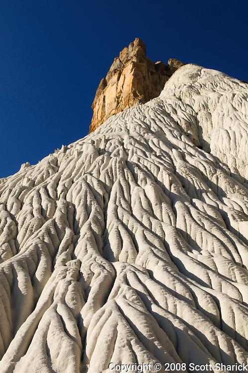 Towering rock on a white rippled hillside in Wahweap Wash, Utah. Missoula Photographer