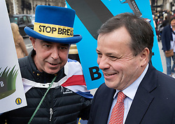 © Licensed to London News Pictures. 27/03/2019. London, UK. Brexit funder Arron Banks (R) argues with Pro-EU campaigner Steve Bray outside Parliament. MPs will hold a series of indicative votes on different Brexit options this evening. Photo credit: Peter Macdiarmid/LNP