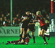 Gloucester, United Kingdom 20001223 Gloucester v Newcastle Premiership,   Newcastle sub. Epi Taione (22), is held as he tries to break out. [Mandatory Credit, Peter Spurrier/ Intersport Images] Played At Gloucester's Kingsholm Ground.