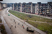 Teenagers are playing footbal in between the high-rise buildings of Lunik IX.  LUNIK IX is populated with almost 100% Roma inhabitans and  in the western-central part of the city of Kosice located in Eastern Slovakia.