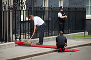 Workers prepare the red carpet at 10 Downing street prior to US President Donald Trumps arrival on the second day of the U.S. President and First Ladys three-day State visit on 4th June 2019 in London, United Kingdom.