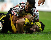 Michael Paterson saves the try from Kurtley Beale<br />Super 14 rugby union match, Waratahs vs Hurricanes, Sydney, Australia. <br />Saturday 14 May 2010. Photo: Paul Seiser/PHOTOSPORT