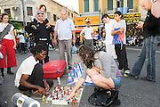 Israel, Tel Aviv, Neve Shaanan neighbourhood people play chess in the pedestrian street