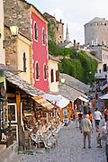 The busy old market bazaar street Kujundziluk with lots of tourist craft and art shops and street merchants. Historic town of Mostar. Federation Bosne i Hercegovine. Bosnia Herzegovina, Europe.
