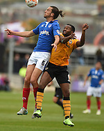 Portsmouth's Christian Burgess (6) gets to a header before Newport's Zak Ansah.Skybet football league two match, Newport county v Portsmouth at Rodney Parade in Newport, South Wales  on Saturday 17th October 2015.<br /> pic by  Andrew Orchard, Andrew Orchard sports photography.