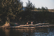 A family fishes and enjoys a late summer day on the banks fo the Dniester River on the outskirts of Tiraspol, Transnistria.<br /><br />(September 10, 2016)