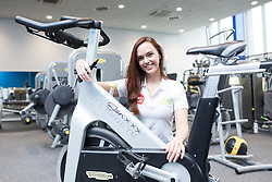"© Licensed to London News Pictures . 01/03/2016 . Manchester , UK . Hollyoaks actress JENNIFER METCALFE (pictured posing with a bike she's signed for a competition) launches a national fundraiser , "" The Better Bike Challenge "" from the East Manchester Leisure Centre in Beswick . The Challenge features 10,000 people cycling one-mile , each donating £1 to #TeamBetter for Sport Relief . Photo credit : Joel Goodman/LNP"