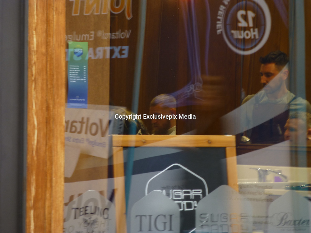 EXCLUSIVE<br /> Cage fighter Conor McGregor pictured out and about in Dublin Connor was pictured going into  Japanese restaurant, then walking into a hairdressers afterwards, getting his hair cut shot from outside through window, walking along street, shooting selfies with fans, shadow boxing very briefly at one point while walking onto Grafton Street.<br /> Charlie Ward is the man with Conor and it is the first time he has been seen out since the death of Portuguese fighter Joao Carvalho (Charlie fought him in April here in Dublin and he unfortunately died the next day<br /> ©Declan Bohan/Exclusivepix Media