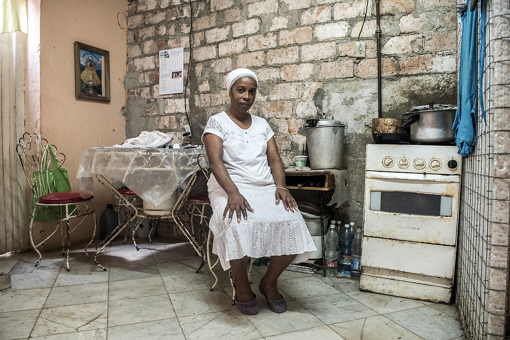Juana DeEspaigne, 58, sits in her apartment in Old Havana, Cuba January 6, 2015. Juana works part time teaching English  and makes about $20 a month. Most Cubans are very happy to hear that dialogue and more negotiations are taking place between the United States and Cuba. The United States announced last month that it will end its fifty-year trade embargo with Cuba and move to normalizing relations. Cuba's budding private sector is strengthening, but still has a long way to go to prepare for the expected stream of tourists. Photo Ken Cedeno