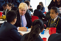 Michaela Community School, Wembley, London, June 23rd 2015. Mayor of London Boris Johnson visits the Michaela Community School, a Free School in Wembley that started taking students in September2014 after battling a certain amount of resistance from locals and unions. During the visit Head Teacher Katharine Birbalsingh took the Mayor on a tour of the school before he participated in a history lesson, prior to sitting down with pupils for brunch. PICTURED: Pupils enjoy the chance to quiz the Mayor of London over brunch.