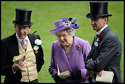 The Queen talks to her racing manager John Warren (left)  in the parade ring. After her horse Estimate wins the Gold Cup at Royal Ascot 2013 Ascot, United Kingdom,<br /> Thursday, 20th June 2013<br /> Picture by Andrew Parsons / i-Images