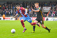 Adam Hammill of Scunthorpe United (47) escapes Eoin Doyle of Bradford City (9) during the EFL Sky Bet League 1 match between Scunthorpe United and Bradford City at Glanford Park, Scunthorpe, England on 27 April 2019.