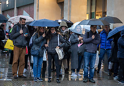 © Licensed to London News Pictures. 26/12/2019. London, UK. Wind and rain hamper shoppers in Oxford Street as the Boxing Day bargain hunters brave the cold and wet weather in the West End for a chance to get discounted designer items. Photo credit: Alex Lentati/LNP