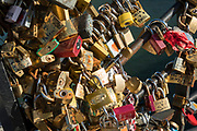 "April, 4th 2020 - Paris, Ile-de-France, France: Latin Quarter, love padlocks on bridge over seine during the first month of near total lockdown imposed in France. A week after President of France, Emmanuel Macron, said the citizens must stay at home for at least 15 days, that has been extended. He said ""We are at war, a public health war, certainly but we are at war, against an invisible and elusive enemy"". All journeys outside the home unless justified for essential professional or health reasons are outlawed. Anyone flouting the new regulations is fined. Nigel Dickinson"