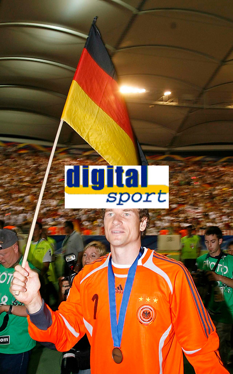 Photo: Glyn Thomas.<br />Germany v Portugal. Third Place Playoff, FIFA World Cup 2006. 08/07/2006.<br /> Germany's Jens Lehmann celebrates third place with the German flag.