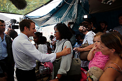 France's President Emmanuel Macron comforts residents during his visit in the French Caribbean islands of St. Martin , Tuesday, Sept. 12, 2017. Macron is in the French-Dutch island of St. Martin, where 10 people were killed on the French side and four on the Dutch. Photo by Christophe Ena/Pool/ABACAPRESS.COM