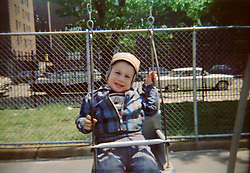 toddler in a swing ( 1960's)