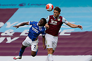 Brighton and Hove Albion defender Tariq Lamptey (2) and James Tarkowski of Burnley (5)  contest an aerial ball  during the Premier League match between Burnley and Brighton and Hove Albion at Turf Moor, Burnley, England on 26 July 2020.