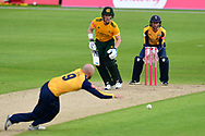 Adam Lyth of Yorkshire attempts to stop drive from Tom Moores of Nottinghamshire during the Vitality T20 Blast North Group match between Nottinghamshire County Cricket Club and Yorkshire County Cricket Club at Trent Bridge, Nottingham, United Kingdon on 31 August 2020.