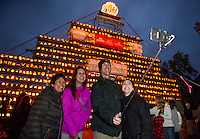 Bridget Penick,Desiree and Jason Hester and Korri Rose visiting from California and Utah enjoy an evening in Laconia during Pumpkin Fest as they take their selfie in front the the Tower.  (Karen Bobotas/for the Laconia Daily Sun)