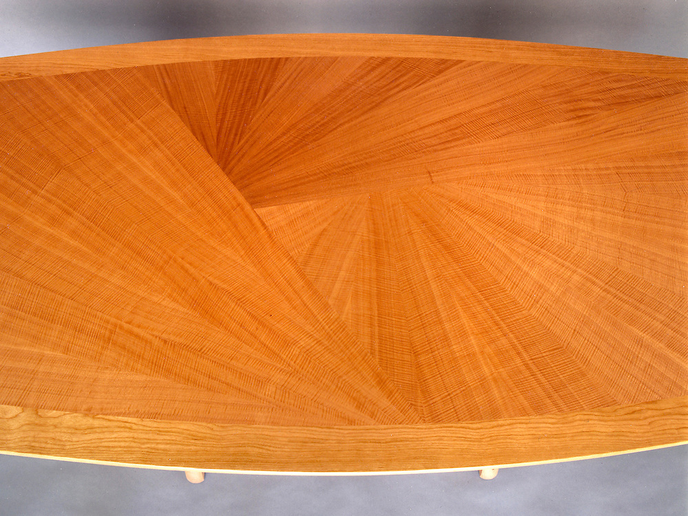 anigre veneer detail of dining table. This table was custom designed and built for a couple in Palo Alto, Ca.