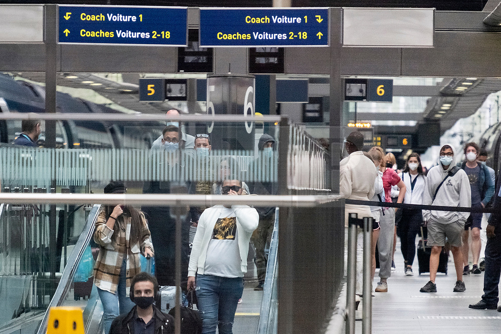 © Licensed to London News Pictures. 15/08/2020. London, UK.  Eurostar travellers from France arrive at St Pancras International train station after the British government imposed 14 day quarantine for anyone travelling from France as of 04:00 this morning.  France has seen a sharp rise in Covid-19 cases in the past week. An estimated 500,000 British holidaymakers are in France for the Summer. Photo credit: London News Pictures