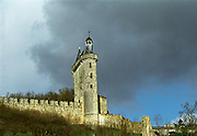 The Chateau de Chinon castle that is on a hilltop behind the village famous for its wine. Dark threatening storm clouds behind the tower. As seen from below from the river Vienne., INDRE ET LOIRE FRANCE