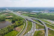 Nederland, Noord-Brabant, Eindhoven, 27-05-2013; Randweg Eindhoven. Knooppunt De Hogt, verkeersknooppunt, aansluiting autosnelweg A2 en autoweg N2 op de A67. Kenmerkend zijn de fly-overs, ook over het riviertje De Dommel.<br /> View on traffic junction De Hogt near Eindhoven, A67 connecting one of the main motorways of the Netherlands: A2 and crossing the river Dommel. <br /> luchtfoto (toeslag op standard tarieven);<br /> aerial photo (additional fee required);<br /> copyright foto/photo Siebe Swart.