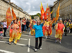 © Licensed to London News Pictures. 25/08/2012. Bath, UK. Jean Meredith carries the Paralympic Flame in a lantern through Bath for a celebration prior to the start of the Paralympic Games 2012.  25 August 2012..Photo credit : Simon Chapman/LNP