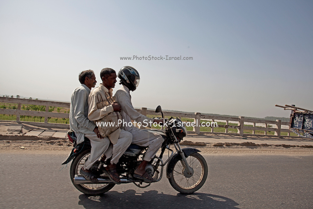 Three men on a motorbike in India