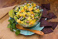 Avocado and mango salad with blue chips