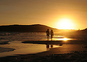 AUSTRALIA - EMU POINT A couple walk along the beach 12/01/2010. STEPHEN SIMPSON...